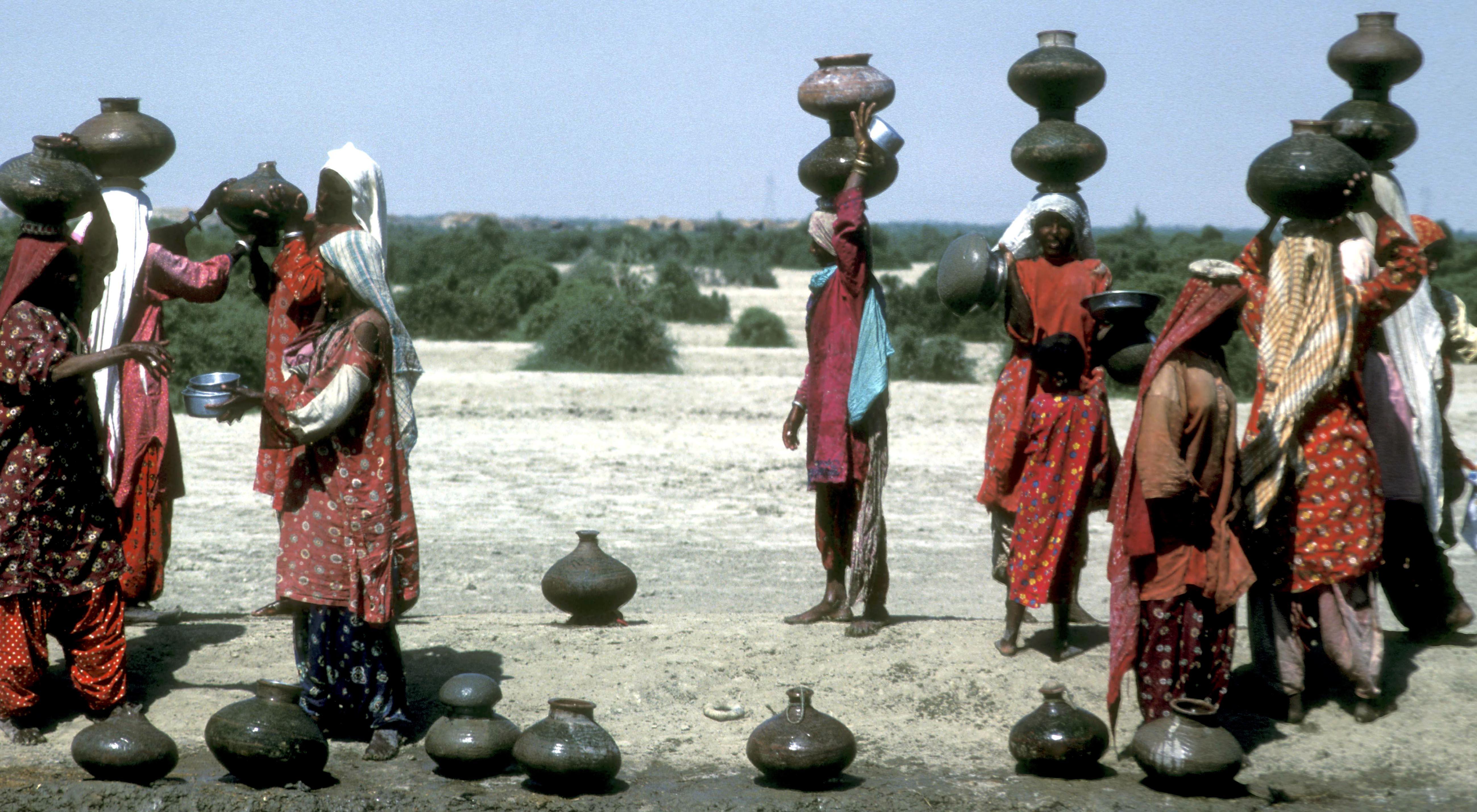 Rural women fetching water from the Desert Canal, near dera Ghazi Khan, west Punjab Pakistan