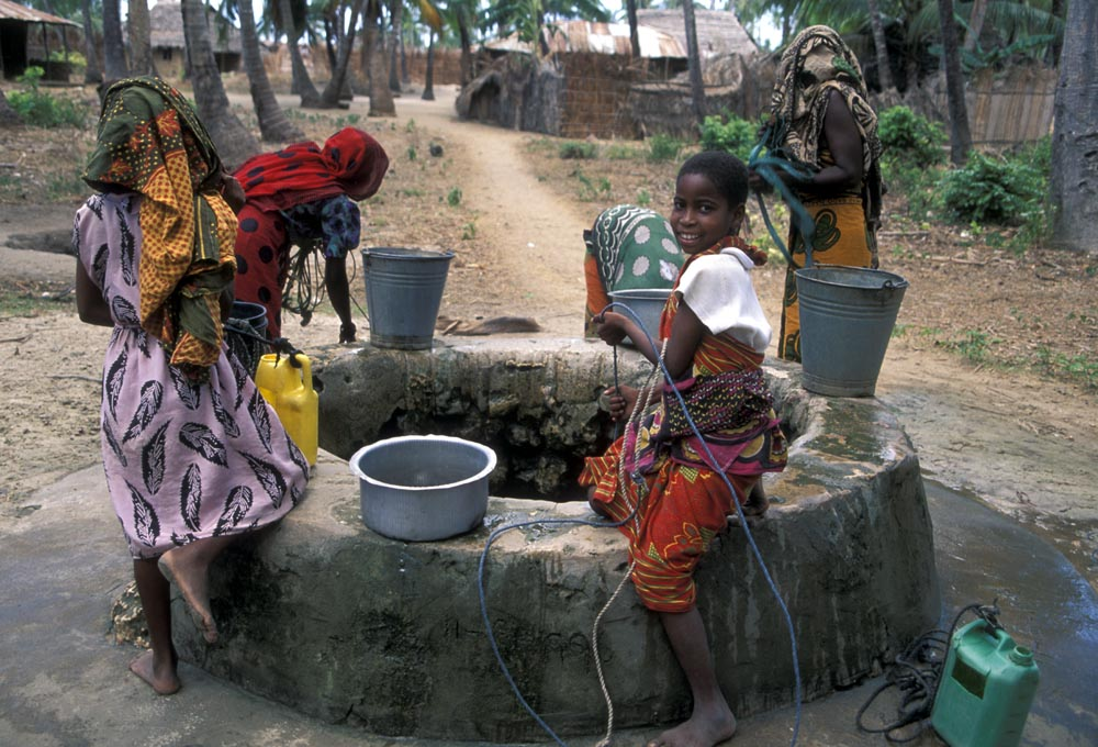 Children fetching water from a well on Mafi'a Island, Tanzania