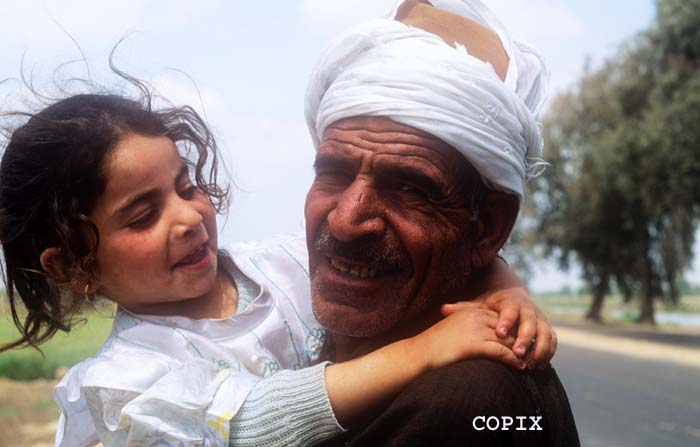 Little girl with her grandfather, rural life Egypt