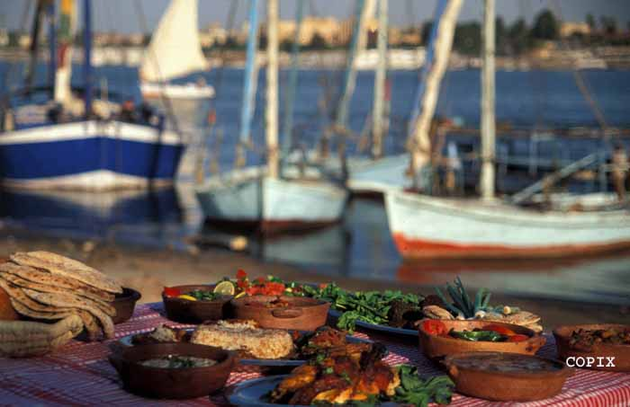 A table of typical Egyptian foods served by the Nile in Luxor