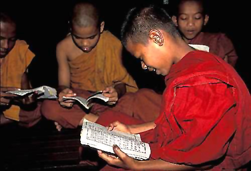Young monks study in a Buddhist monastery in Burma