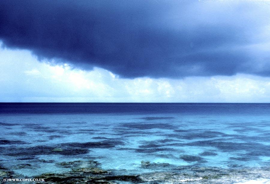 Tropical storm over Rangiroa atoll lagoon, Tuamotu archipelago, Pacific Ocean