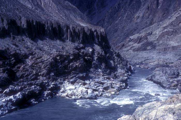 Indus river flowing through the Karakorams from its source in Tibet. Water rocky Pakistan `northern areas` swift river