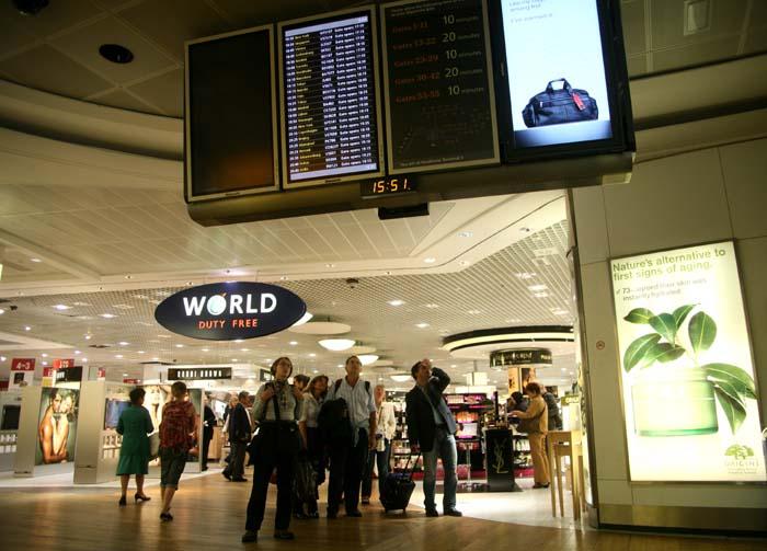 Airport flight monitor duty-free area Heathrow